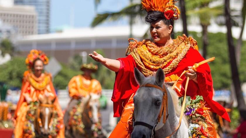 Lanai Pau Princess Ronica Ann Ibara waves to the crowd during the 2016 Aloha Festival Floral Parade