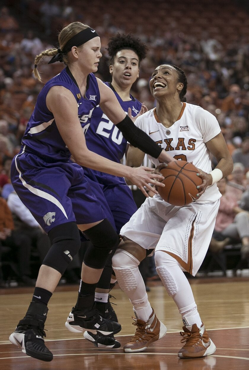 Texas' Brianna Taylor looks for a shot while Kansas State's Shaelyn Martin, left, reaches for the ball and Bri Craig helps defend during the first half of an NCAA college basketball game Wednesday, Feb. 17, 2016, in Austin, Texas. (Deborah Cannon/Austin American-Statesman via AP)