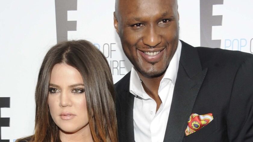 Khloe Kardashian and Lamar Odom, shown in April 2012, have called off their divorce.