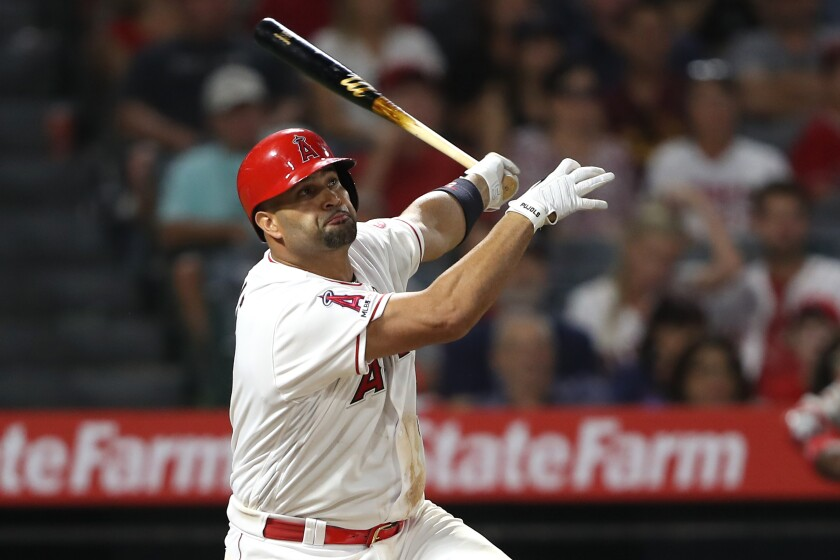 The Angels' Albert Pujols hits a three-run homer in a 10-4 win over the Red Sox on Aug. 31, 2019.