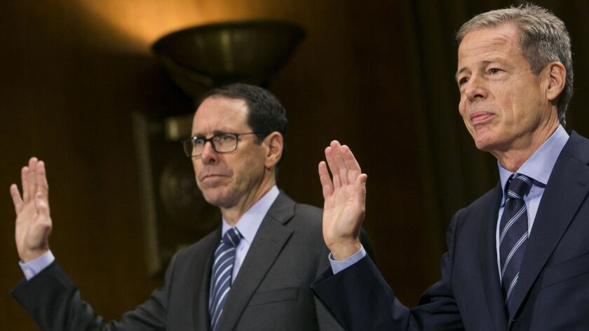 AT&T Chairman Randall Stephenson, left, and then-Time Warner Chairman Jeffrey Bewkes preparing to testify before a Senate committee in 2016 about their pending merger.