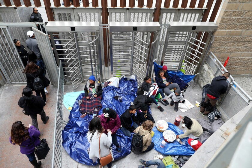 TIJUANA, BAJA CALIF. -- TUESDAY, MAY 1, 2018: Central Americans wait to be let through to U.S. Custo