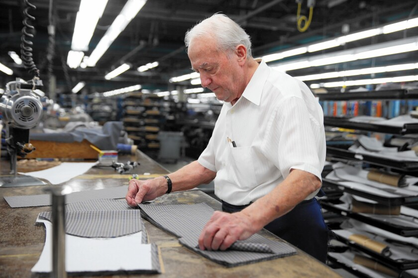 "Mazlam Dato handles fabric Feb. 22, 2017, at the Hart Schaffner Marx suit factory in Des Plaines. The suit-maker imports wool fabric for its clothes. If a border adjustment tax is enacted, ""my taxes would be through the roof,"" said Doug Williams, CEO of the W Diamond Group, which holds the license for the brand."