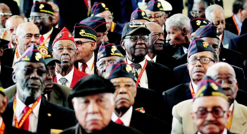 Surviving members of the Montford Point Marines attend a Congressional Gold Medal ceremony on Capitol Hill in Washington on Wednesday. Almost 400 of the first African Americans to serve in the Marines attended the ceremony.
