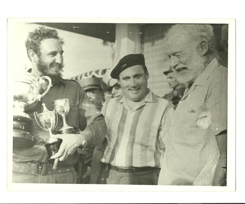 Ernest Hemingway (far left) and the Director of the Cuban Institute of Sports, Physical Education, a