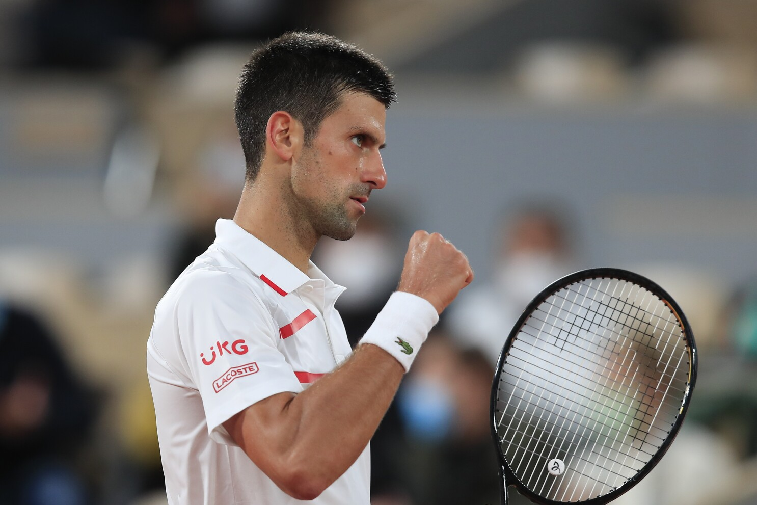 French Open Novak Djokovic Near Flawless In First Round Los Angeles Times