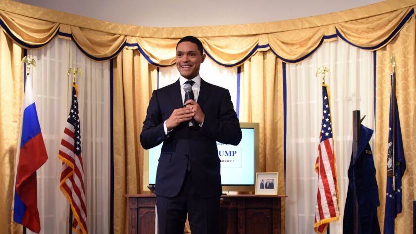 """Trevor Noah at """"The Daily Show Presents: The Donald J. Trump Presidential Twitter Library,"""" designed"""