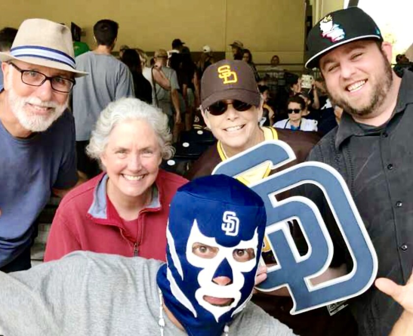 Anne Greenstone, back row in Padres hat, and son Michael Whiteside, right, with friends during a Padres game at Petco Park.