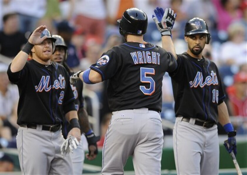 New York Mets' David Wright (5) celebrates his three-run home run against the Washington Nationals with teammates Justin Turner (2) and Angel Pagan, right, during the first inning of a baseball game on Friday, Sept. 2, 2011, in Washington. (AP Photo/Nick Wass)