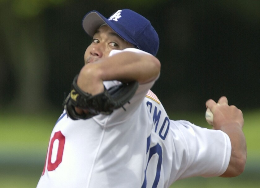 Dodgers pitcher Hideo Nomo warms up before pitching against the Florida Marlins in a 2002 exhibition game.