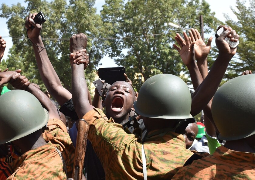 A crowd gathers in front of army headquarters in Burkina Faso's capital, Ouagadougou, demanding that the army take over after the resignation of President Blaise Compaore on Oct. 31.