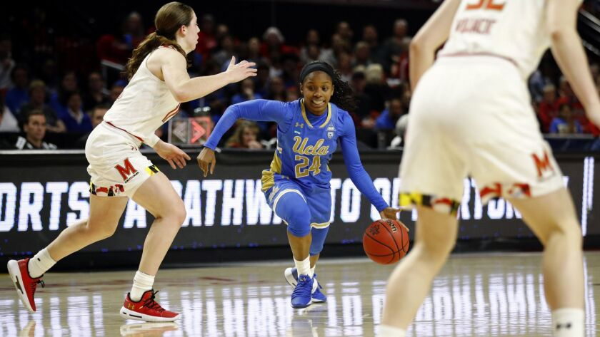 UCLA guard Japreece Dean drives against Maryland guards Taylor Mikesell, left, and Sara Vujacic (32) during the first half of a second-round game in the NCAA women's tournament on Monday in College Park, Md.
