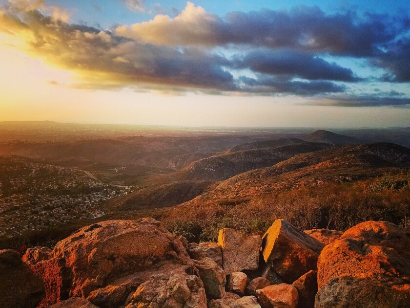 Golden light bathes the top of Cowles Mountain looking out toward the Pacific Ocean.