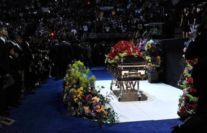 In this image released by the Jackson family, a casket holding Michael Jackson's body sits in front of the stage during a memorial for the pop star at the Staples Center on Tuesday, July 7, 2009 in Los Angeles. (AP Photo/courtesy of The Jackson Family, Kevin Mazur)