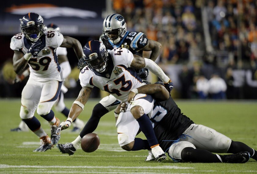 Denver Broncos' T.J. Ward (43) fumbles after making an interception during the second half of the NFL Super Bowl 50 football game Sunday, Feb. 7, 2016, in Santa Clara, Calif. (AP Photo/Ben Margot)