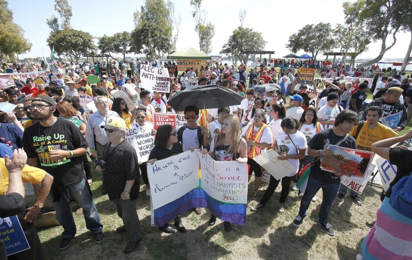 Protesters rallying against ALEC gathered at Embarcadero North Park and later marched to the Manchester Grand Hyatt Hotel Monday afternoon in San Diego.