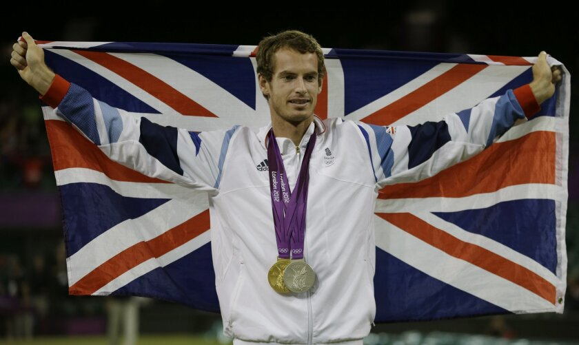 "FILe - In this Aug. 5, 2012, file photo, Andy Murray of Great Britain poses with his gold and silver medals in tennis at the All England Lawn Tennis Club in Wimbledon, London at the 2012 Summer Olympics.  The ""Big 4"" of men's tennis is enthusastic about the Rio de Janeiro Olympics, unlike their cou"