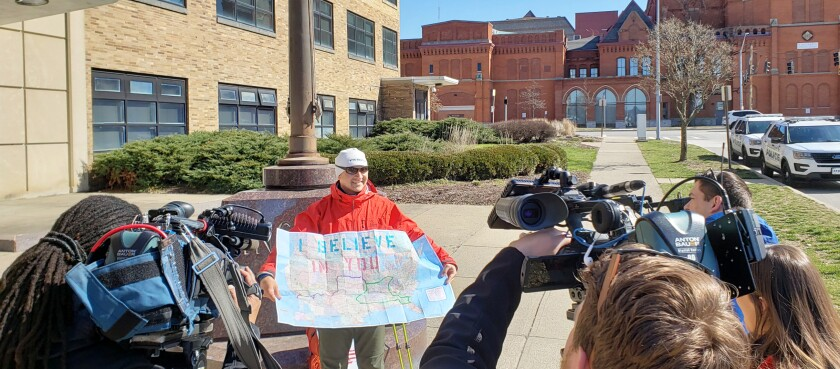 Stephen Meyers shows his walking route to television cameras.