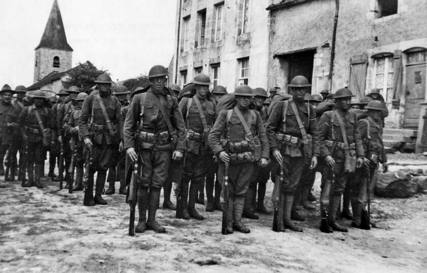 1918: U.S. Army 91st Division troops leave a French village where they had been billeted before heading to the front during the Arnonne-Meuse offensive.