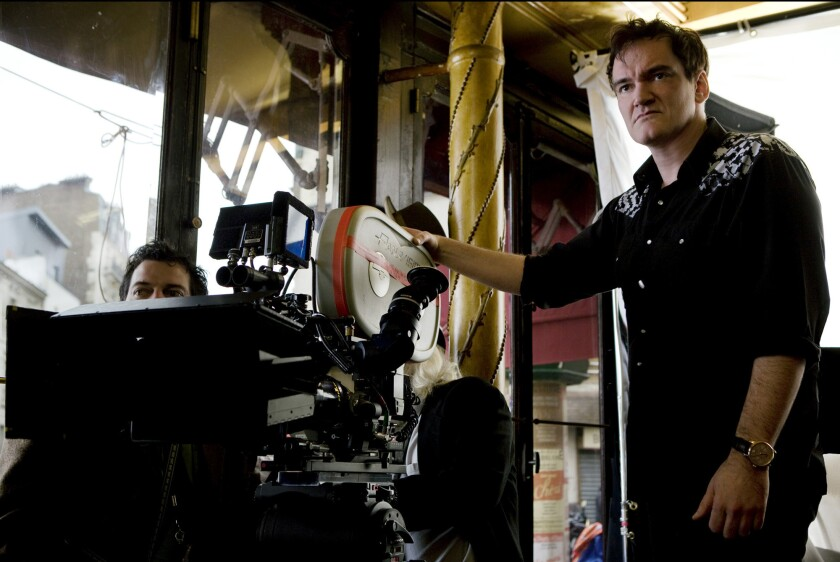 "Quentin Tarantino, seen on the set of his movie ""Inglourious Basterds,"" is a proponent of shooting on film rather than digitally, and his New Beverly Cinema shows only celluloid prints of movies."