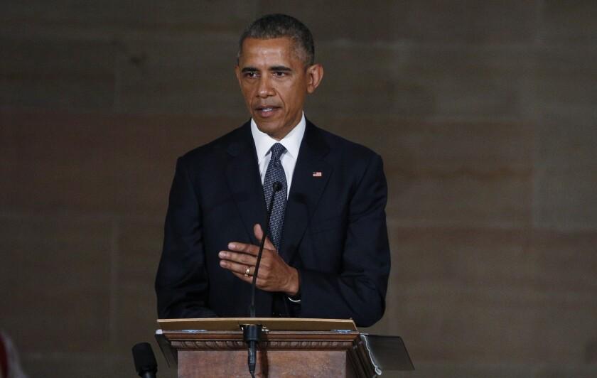 President Obama delivers a eulogy during funeral services for Vice President Joe Biden's son, former Delaware Atty. Gen. Beau Biden.