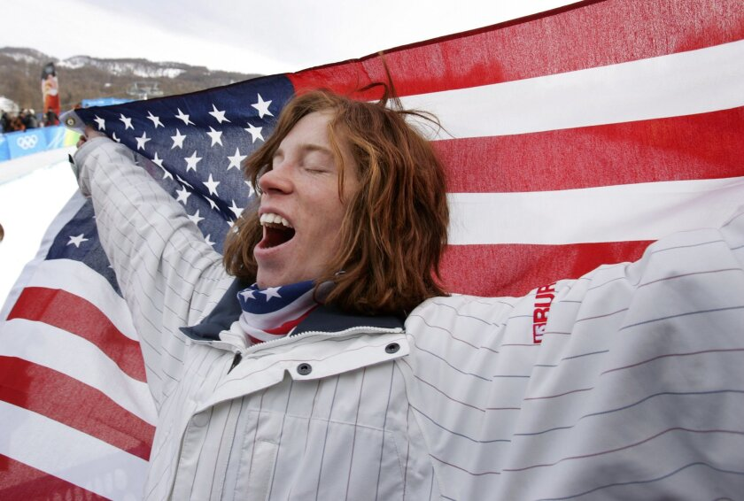 Shaun White winning gold in snowboarding at the Olympics in Turino.