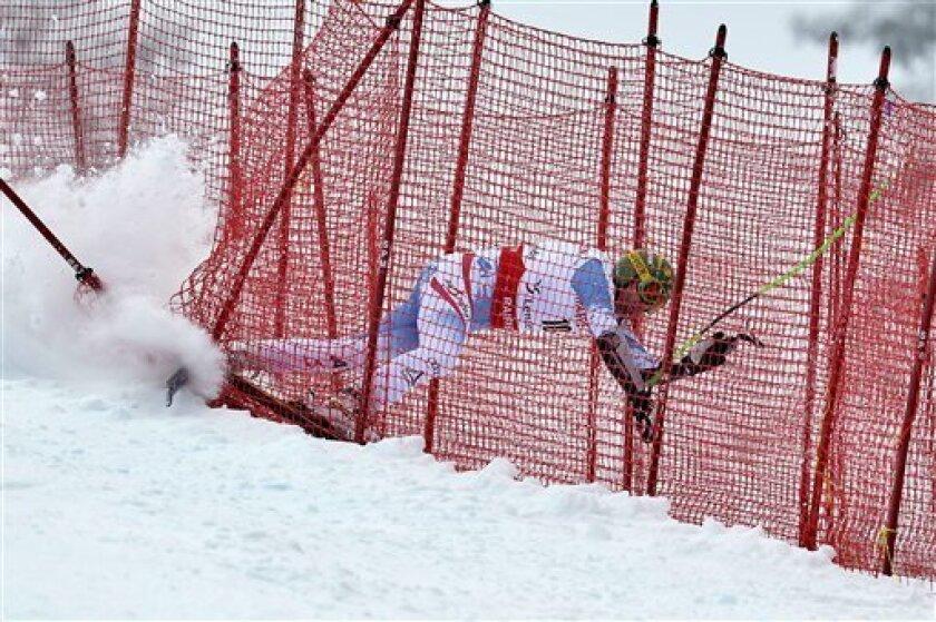 Klaus Kroell, of Austria, crashes in the safety net, during the men's World Cup Super G of the Alpine Ski World Cup finals, in Parpan - Lenzerheide, Switzerland, Thursday, March 14, 2013. (AP Photo/Keystone, Peter Schneider)