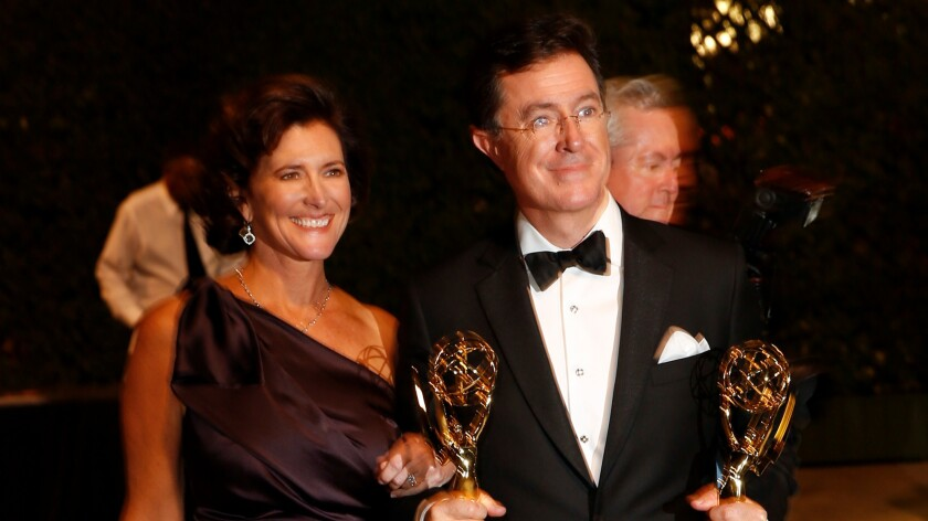 Stephen Colbert with his wife, Evelyn McGee-Colbert, after he won two Emmys in 2013.