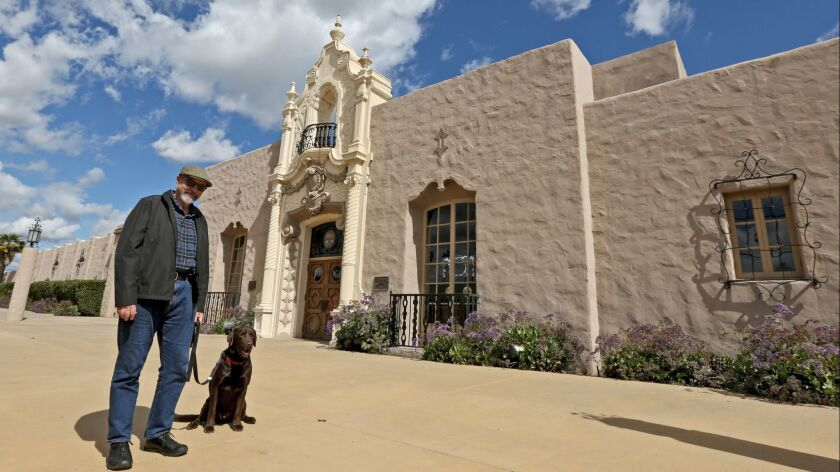 """Silent film location expert, Paul Ayers, with his dog, Toby, at the Glendale train station. He's standing near where Buster Keaton stood in the 1927 comedy, """"College."""""""
