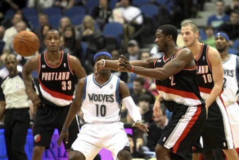 Portland Trail Blazers' Wesley Matthews, right, makes a pass in front of Minnesota Timberwolves' Jonny Flynn (10) in the first quarter of an NBA basketball game, Friday, Jan. 7, 2011, in Minneapolis. (AP Photo/Stacy Bengs)