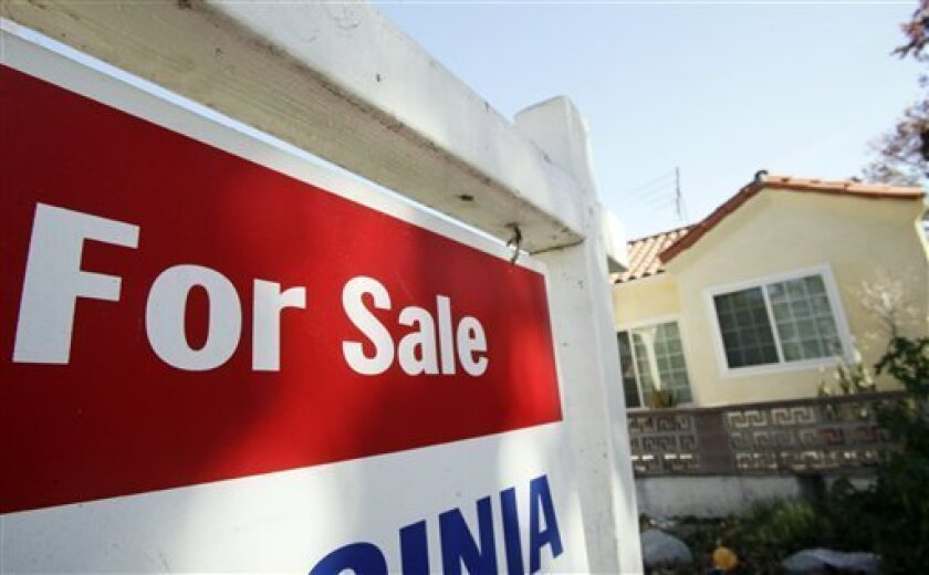In this photo made Tuesday, Nov. 17, 2009, a 'for sale' sign is seen outside a home in Los Angeles. The average interest rate for a 30-year mortgage dropped to a record low of 4.71 percent this week, pushed down by an aggressive government campaign to reduce borrowing costs. (AP Photo/Reed Saxon)