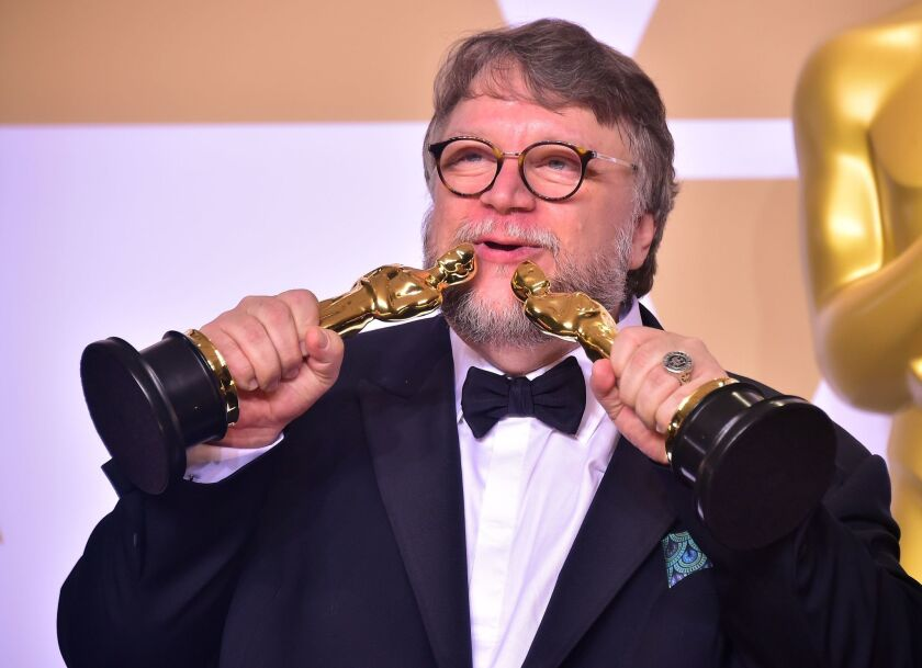 Director Guillermo del Toro poses in the press room with the Oscars for best picture and best director during the 90th Annual Academy Awards on March 4, 2018, in Hollywood, California.