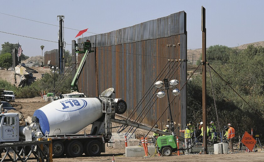 "Sections of a 30-foot high ""bollard style wall"" are constructed in Yuma, Ariz."