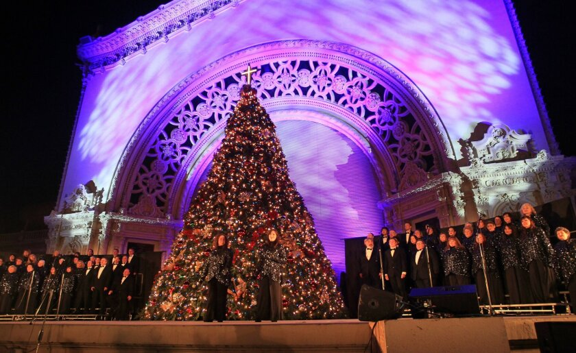 """Balboa Park December Nights, day 1- The Del Cerro Baptist Church Choir performs the """"Living Christmas Tree"""" on the Organ Pavilion stage."""
