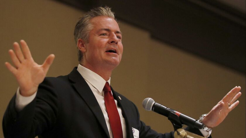 Travis Allen, a candidate for chair of the California Republican Party, speaks to a meeting of the Orange County GOP in Costa Mesa.