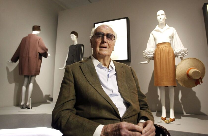 """French designer Hubert de Givenchy in front of his creations during an interview on his exhibition """"Hubert de Givenchy"""" at the Thyssen-Bornemisza Museum in Madrid."""