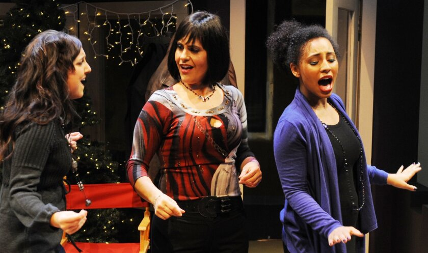 """Renee Rebold, Michelle Pereira and Mandi Jo John (left to right) in Lamb's Players Theatre's """"Festival of Christmas: The Spirit of Christmas Present."""""""