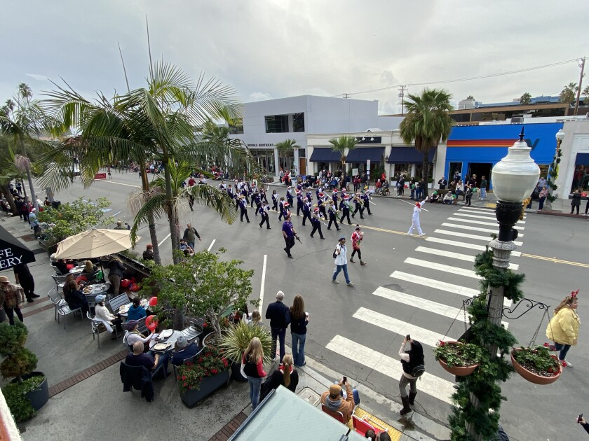 It was a Christmas miracle that the 62nd La Jolla Christmas Parade escaped rain. However, the threat of it cut significantly into attendance.
