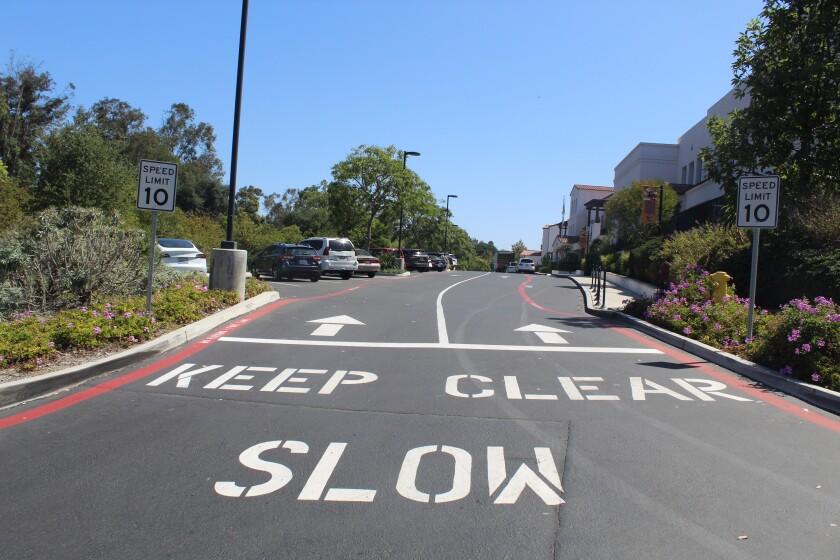 "The Rancho Santa Fe School District added speed limit signs and ""Slow"" painting in the parking lot to curb speeding."
