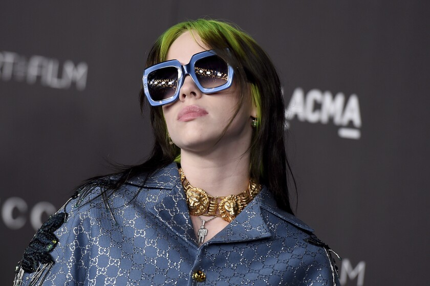 "FILE - This Nov. 2, 2019 file photo shows Billie Eilish at the 2019 LACMA Art and Film Gala in Los Angeles. Eilish will be the first recipient of the Apple Music Award for global artist of the year, one of three honors for the pop singer. Apple announced Monday that Eilish's ""When We All Fall Asleep, Where Do We Go?"" has been named album of the year. Eilish and her brother Finneas will also receive songwriter of the year honors. (Photo by Jordan Strauss/Invision/AP, File)"
