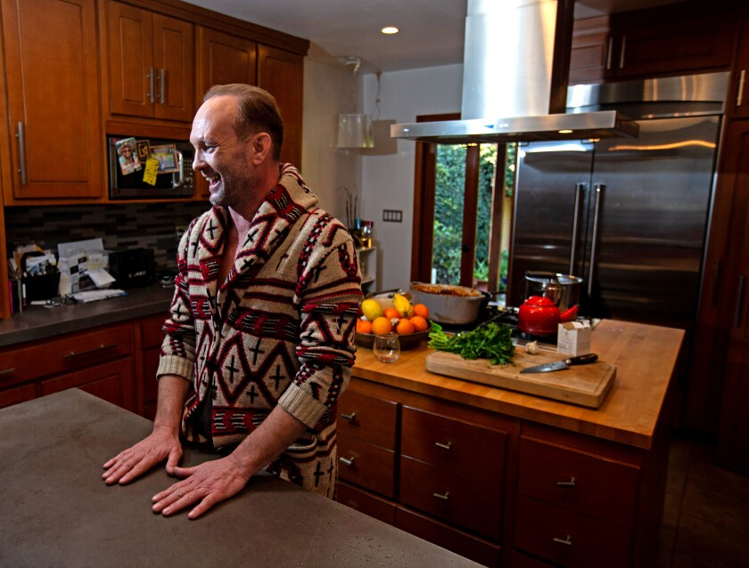 """Los Angeles, CA., January 15, 2020: Andrew Howard cooks in his kitchen on Wednesday, January 15, 2020 in Los Angeles, California. Howard stars on the HBO series, """"Watchmen,"""" and in the upcoming HBO limited series, """"Perry Mason."""" currently filming, as well as Christopher Nolan's new film, """"Tenet.""""(Jason Armond / Los Angeles Times)"""