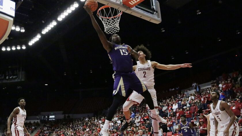 Washington forward Noah Dickerson (15) shoots in front of Washington State forward CJ Elleby (2) during the second half on Saturday.