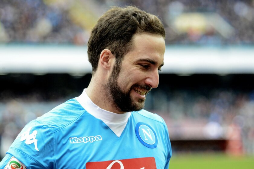 Napoli's Gonzalo Higuain reacts after missing a scoring chance during a Serie A soccer match between Napoli and Carpi, at the San Paolo stadium in Naples, Italy, Sunday, Feb. 7, 2016. (AP Photo/Salvatore Laporta)