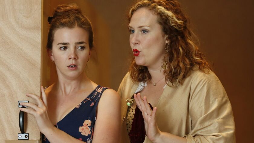"""Sarah Shafer, left, and Caitlin Lynch rehearse a scene from San Diego Opera's season-opening production of Wolfgang Amadeus Mozart's """"The Marriage of Figaro."""""""
