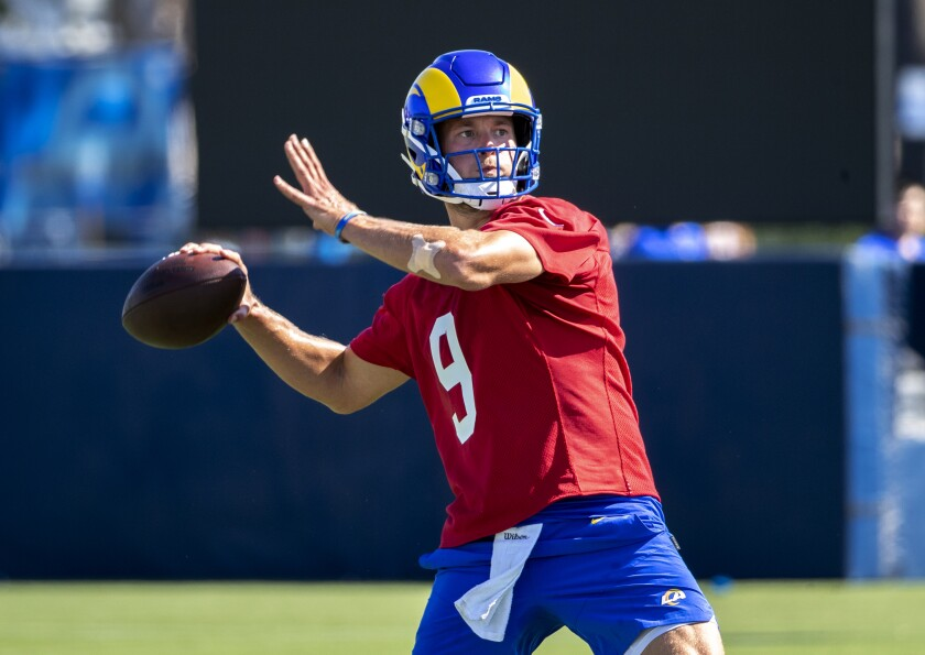 Rams starting quarterback Matthew Stafford throws a pass on the first day of training camp Wednesday at UC Irvine.