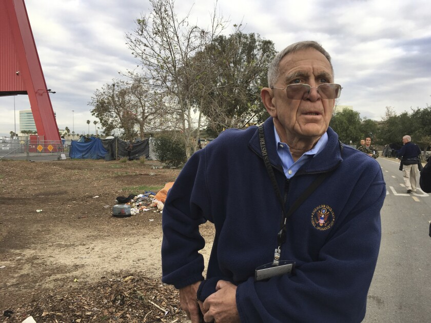 David O. Carter, a U.S. District Judge, tours a homeless encampment in Santa Ana, Calif.
