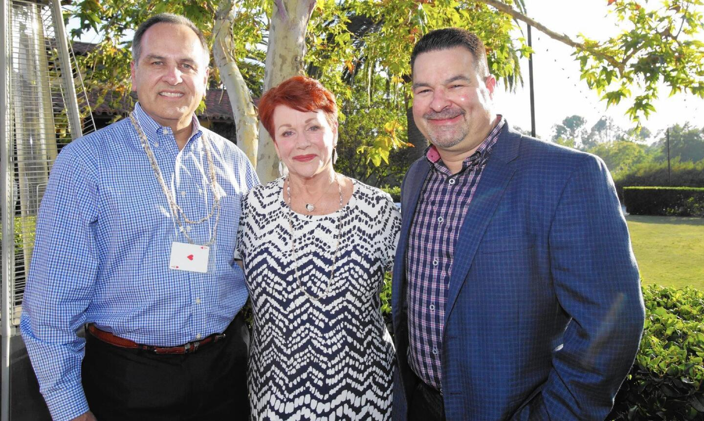 Alex Morales, honored guests Peggy Goldwater Clay and Kevin Prewett at 2016 Summer Clambake for Children's Bureau OC.