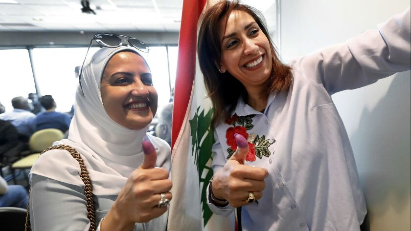 A new law allows Lebanese expatriates to vote in their nation's parliamentary elections. Roba Chanti, left, and her cousin Tala voted at the Lebanese Consulate in Southfield, Mich., on April 29, 2018.