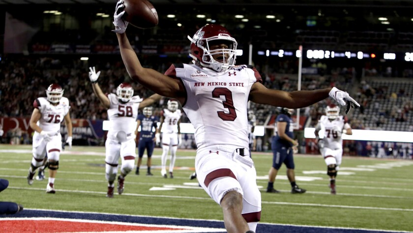 New Mexico State running back Larry Rose III (3) reacts after scoring a touchdown in overtime to def