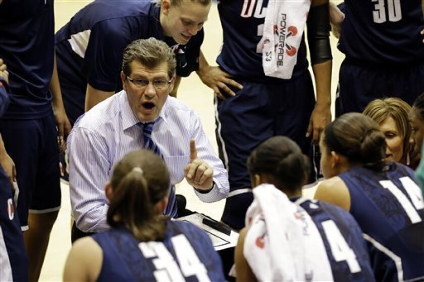 Connecticut head coach Geno Auriemma talks to his team during a timeout in the first half of an NCAA college basketball game against Georgetown, Wednesday, Jan. 9, 2013, in Washington. (AP Photo/Alex Brandon)